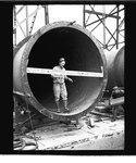 Worker standing in a penstock liner