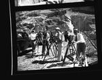 Cameramen film an event atop Grand Coulee Dam