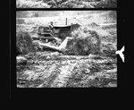 Bulldozer clearing brush