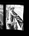 Worker at a conveyor belt
