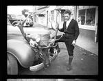 Elk head tied to a car bumper