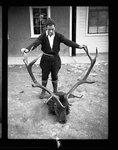 Man posing with elk head