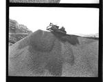 Bulldozer on top a gravel mound