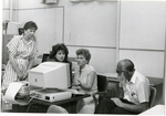 Woman instructs staff or faculty on use of computer by Eastern Washington University