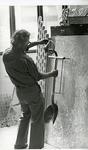 Ruben Trejo looking at a sculpture resembling a shovel