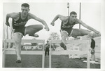 Roger Goodspeed and Gary Fuller clearing a hurdle by Publications, Eastern Washington State College