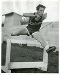 Ed Gilden running hurdles by Publications, Eastern Washington State College