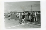 Runners cross finish line on outdoor track by Publications, Eastern Washington State College