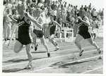 Eastern track event with crowd in the background by Publications, Eastern Washington State College