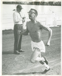 Shirtless runner timed by coach by Publications, Eastern Washington State College