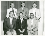 Five Eastern track members holding awards by Publications, Eastern Washington State College