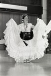 Ballet Folklorico dancer posing with dress raised at Eastern Washington University