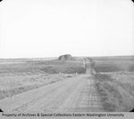 Erratic boulder north of Withrow by Otis W. Freeman