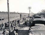 Troops disembarking from a train