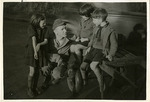 Von Behren with group of children by Robert Gillette