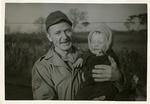 Von Behren holding crying baby by Robert Gillette