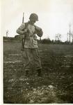 Paratrooper Robert Gillette adjusts strap during a photo shoot by Robert Gillette
