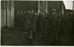 Lieutenant Colonel Batchellor standing at attention with other soldiers