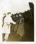 Lieutenant Colonel Batchellor shaking hands with soldiers standing in a receiving line