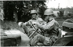 Two servicemen in a Willys Jeep