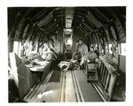 Adrianson, Davis, and Gabriel inside an Airborne aircraft by Robert Gillette
