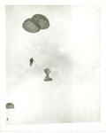 Paratrooper descending with parachute deployed