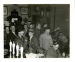 Crowd gathered in a public house in Woodhouse Eaves, England