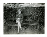 Servicewoman seated on bench