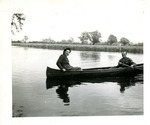 Gillette, Robert and an unidentified servicewoman in a canoe