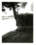 Unidentified servicewoman standing under a tree.
