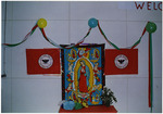 Banner with Our Lady of Guadalupe flanked by United Farm Workers flags