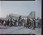 555th Parachute Infantry putting on jump gear for fighting forest fires by United States. Army Air Forces