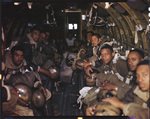 555th Parachute Infantry seated inside a troop carrier by United States. Army Air Forces