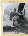 Sergeant Leon Richardson of the 555th Parachute Infantry climbing into a C-47 troop carrier by United States. Army Air Forces